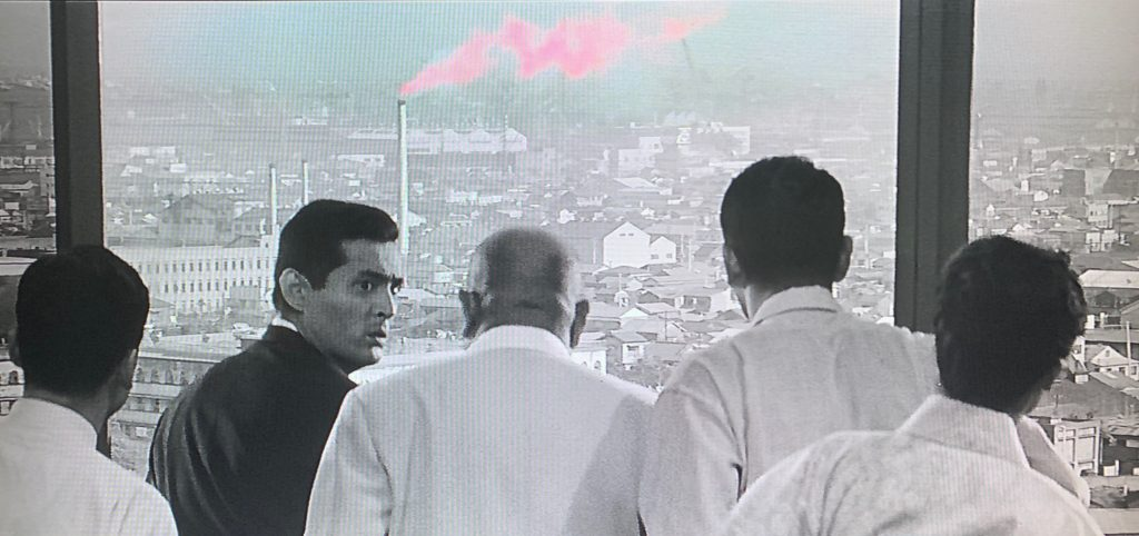 pink smoke in a black and white movie